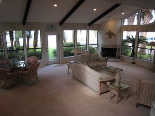 Rockport house photo - Family room with game table, fireplace, & view of bay