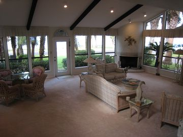 Family room with game table, fireplace, & view of bay