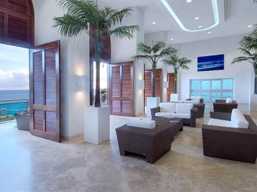 Main lobby at The Cliff with massive sea views with a cooling breeze.