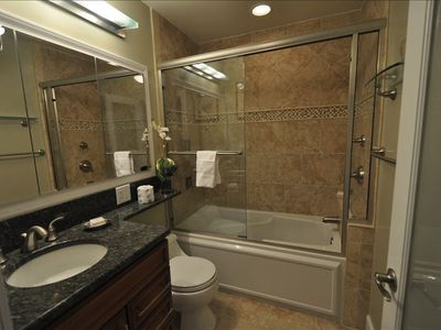 Spa bath, extra counter space and electrical outlets, makeup mirror, hair dryer