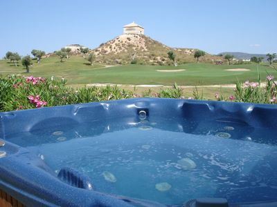 Hot tub and view of golf course