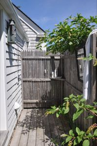 Outdoor shower in side yard off MBR dressing area.