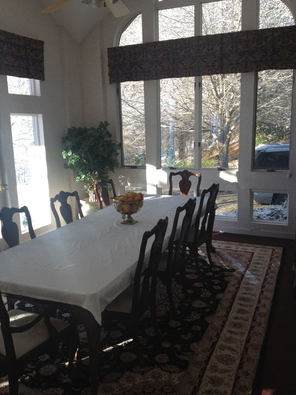 Formal dining room with natural light. Can seat up to 16 with 20 possible