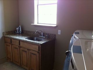 Full size laundry room with new washer / dryer