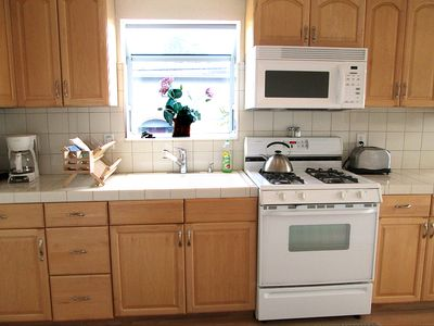 The Fully Equipped Bright and Cheery Kitchen has a View of Corcoran Lagoon Beach