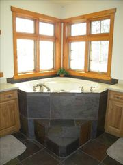 Menominee estate photo - whirlpool tub in master bath