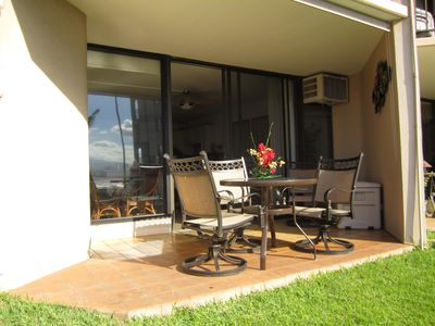 lanai with 4 swivel rockers and dining table