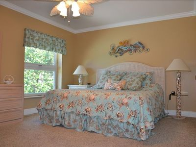 Spacious master bedroom features king bed, private bath & flat screen TV.