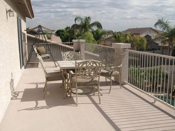 Balcony with swing and patio doors to master bedroom and upper family room.