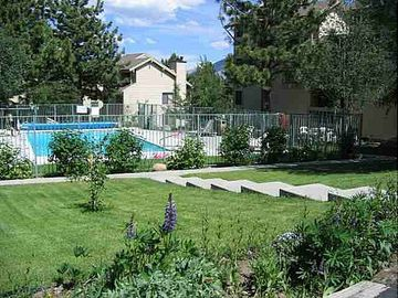 Enjoy summer days in the large swimming pool just steps away from the condo