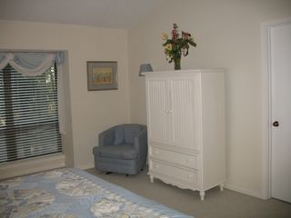 Sea Pines condo photo - Bedroom has TV in Armoire and large walk in closet
