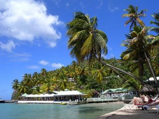 Marigot Bay apartment photo - The beach and restaurant - less than 5 minute walk from Ocean Cottage