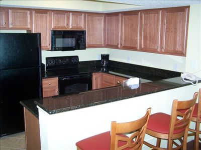 Kitchen with all Granite counter tops and Bar with solid wood stools