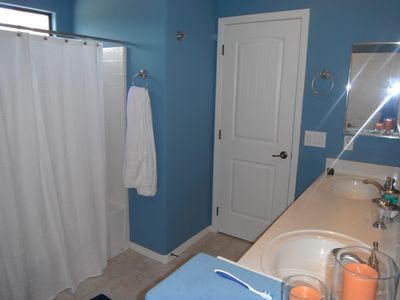 This Jack and Jill bathroom is shared between two of the bedrooms in the house.