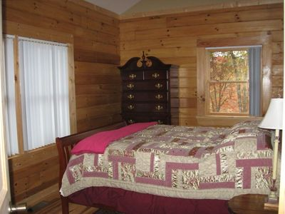 Upstairs guest bedroom, queen size bed, great view of the big water and the cove
