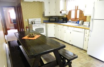 Eat-in kitchen with large family-style table.