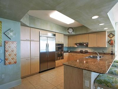 Fully equipped kitchen with granite countertops and Kitchen Aid appliances.