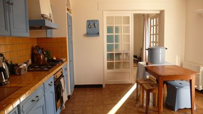 Full equipped kitchen with front terrace entrance