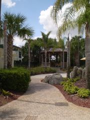 Kissimmee condo photo - Walkway within complex