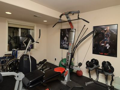 Fully stocked exercise room and additional workout area.