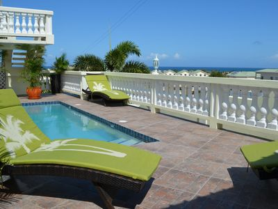 Pool with views of the Atlantic ocean. These chairs are just magnificent!