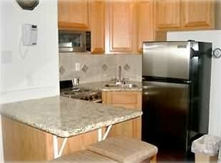 Updated kitchen with granite countertops & stainless appliances