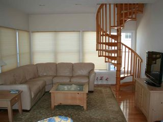 Family room, winding stairs up to kitchen, dining room, and living room - Holgate house vacation rental photo