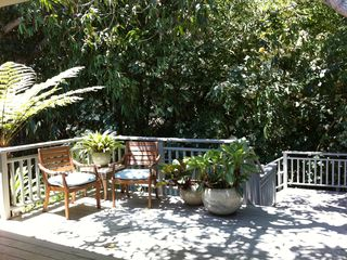 Kailua house photo - Sitting area under mangoes on upper deck