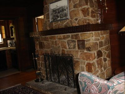 Large  fireplace off the upper convenience kitchen is a great reading spot.