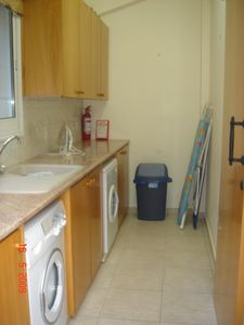 Utility room, Washer, Dryer, Ironing Board, Sink
