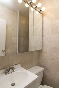 Marble Bathroom, Gorgeous Tiles, Bath Tub, Shower, new Vanity & medicine cabinet