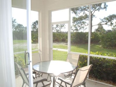 Enjoy sitting on the quiet lanai with open grass area.
