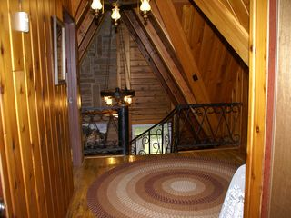Lebanon cabin photo - Upper hallway looks over lower level and spiral staircase