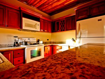 fully furnished kitchen with modern upgraded appliances. granite counter tops