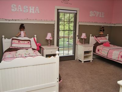 pink bedroom with 2 single beds