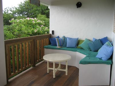 LOUNGE AREA ON MAIN DECK FOR READING AND RELAXING.