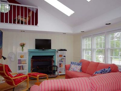 Open, airy living room with loft, fireplace, HDTV + DVR, BRD/DVD/CD player.
