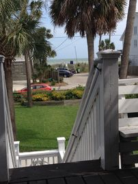 Folly Beach house rental - View of the ocean from the front 2nd floor porch outside the living room.