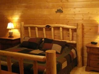 Towering pine ceilings, hand peeled pine log king beds !