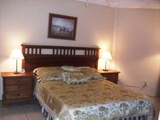 Daytona Beach Shores condo photo - Queen bed in roomy bedroom with TV