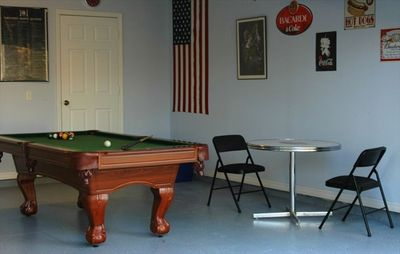 Games Room with pool table, air hockey, darts and bar table.