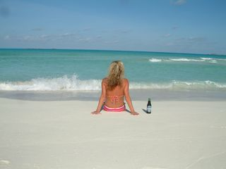Great Exuma villa photo - Sometimes you just need to chill on the beach with your thoughts and a beer!