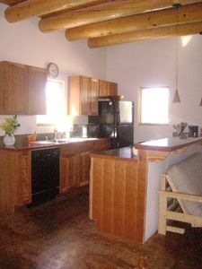 Traditional log ceiling beams in the kitchen, dining and living room