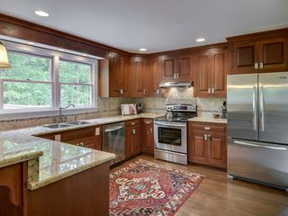 Franklin house photo - Beautiful kitchen with granite countertops and cherry cabinets