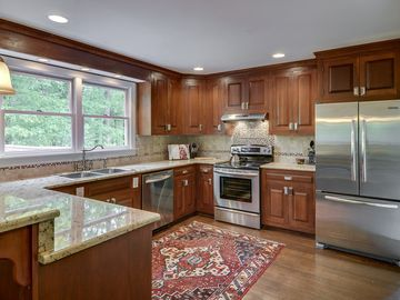 Beautiful kitchen with granite countertops and cherry cabinets