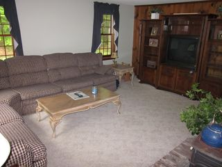 Meredith house photo - Cozy family room, pull out couch, wall entertainment center, stereo, dvd player