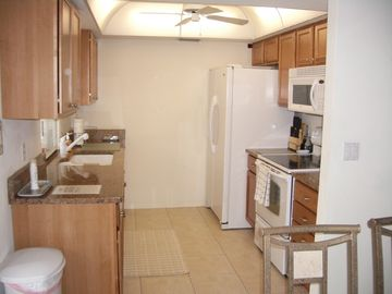 Updated, fully-equipped kitchen with granite countertops & new appliances