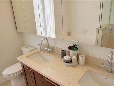 Vancouver condo rental - Ensuite Master Bath with marble countertops, Glass shower, Deep soaker tub