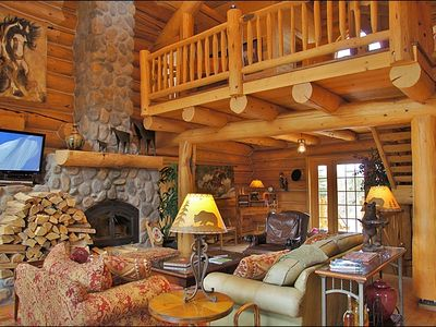 Living Room & Loft - HDTV, DVD, iPod Stereo, a 25 foot rock fireplace & vaulted ceilings.
