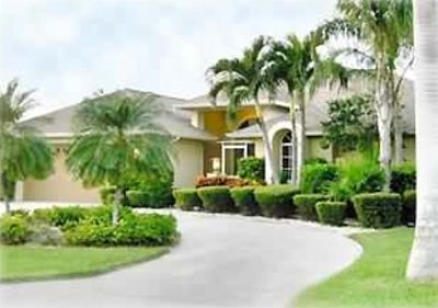 BEAUTIFUL HOME WITH LUSH LANDSCAPING & GREAT FLOOR PLAN